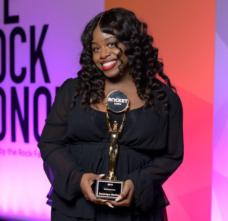 Image of winner holding 2019 Rock Award.