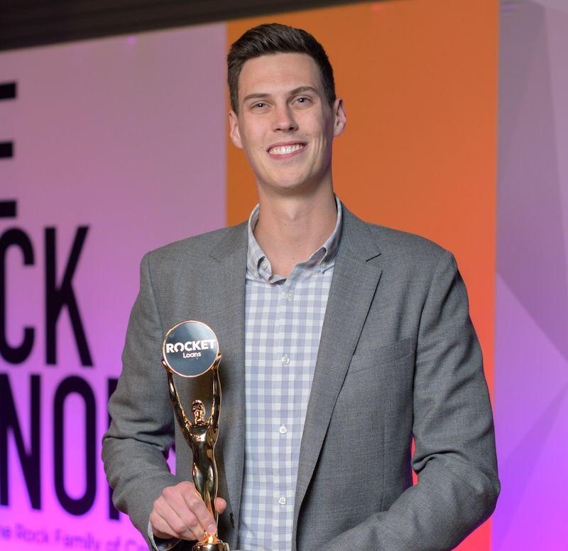 Image of winner holding Rock award.
