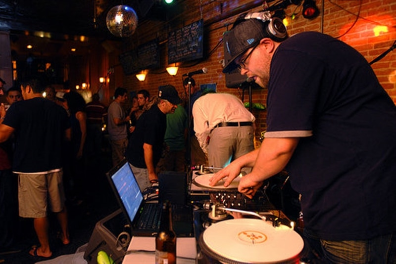 Image of Team Member Norm DJ-ing in downtown Detroit.