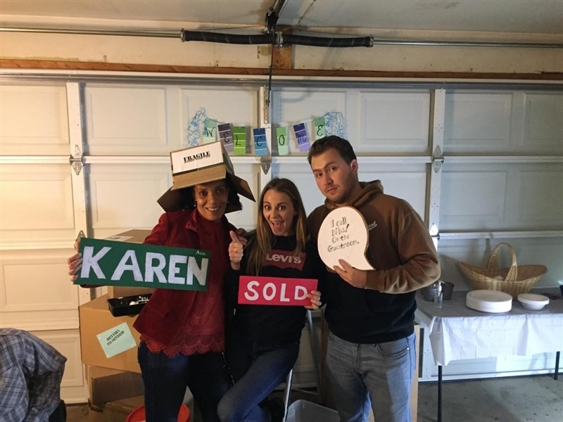 Image of friends holding up signs for photo.