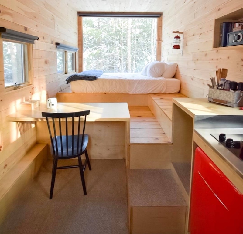Tiny home, clean kitchen and bedroom layout.