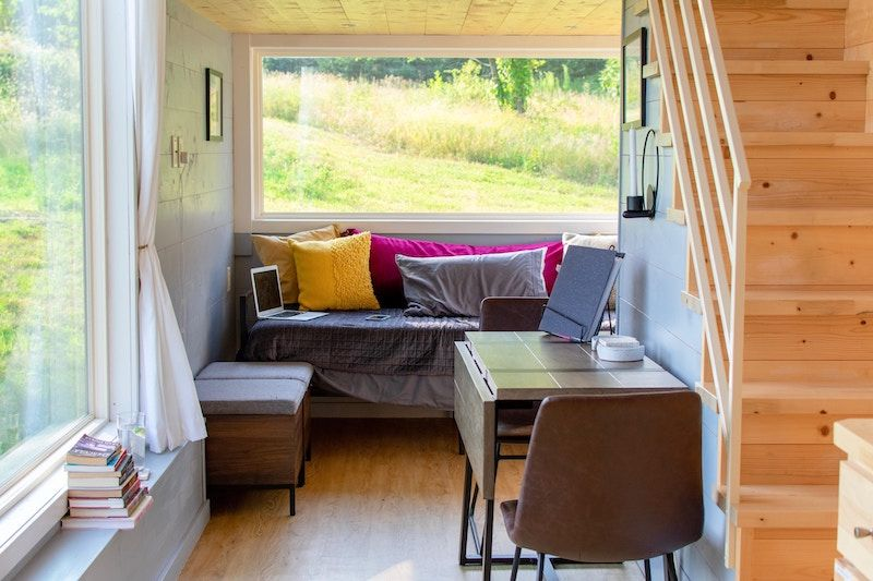 Tiny home, clever dining space layout.