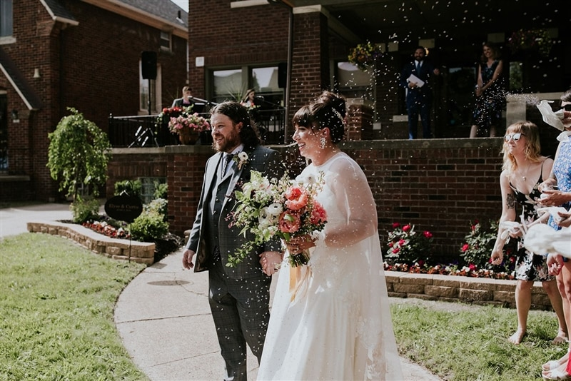 Image of couple down the isle, courtesy of Spoke Events + Erin Hannum Photography