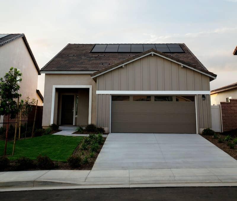 Image of home with new garage door added.