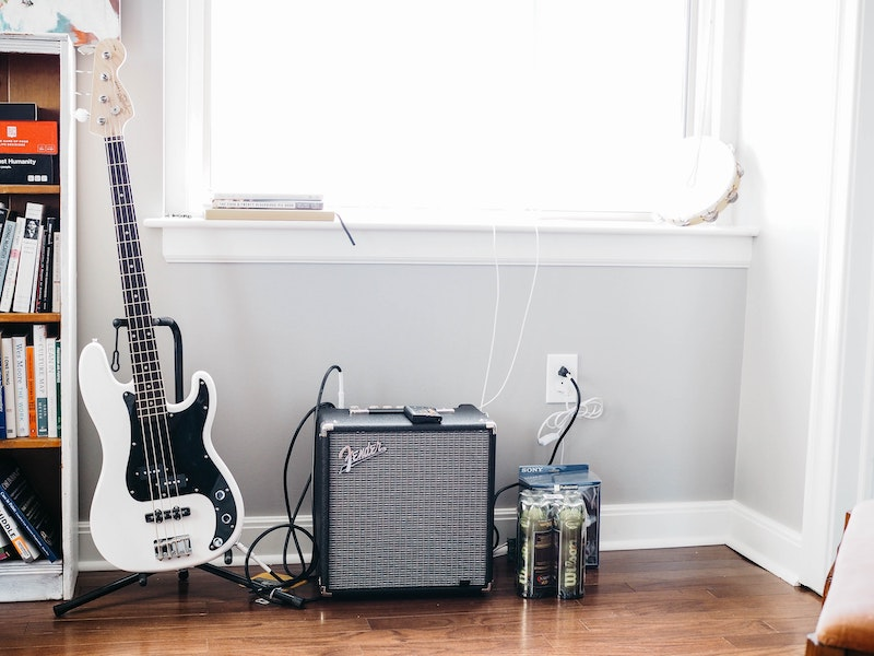 Image of new electric guitar and amp inside home studio