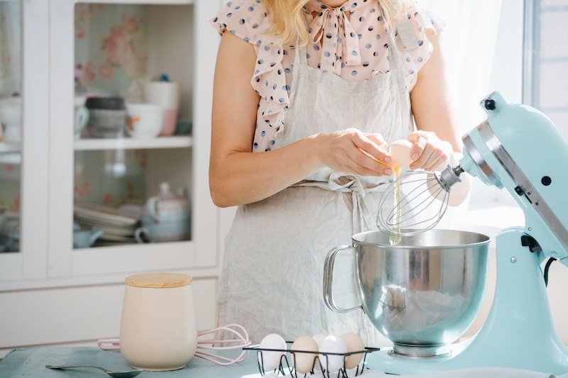 Image of woman using kitchen mixer, her 2020 holiday gift