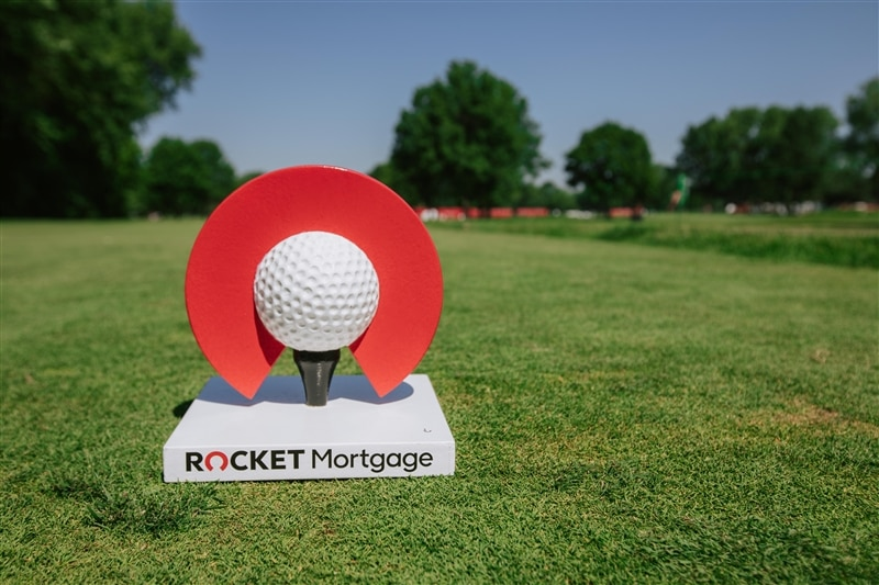 Image of Rocket Mortgage Classic trophy on turf.