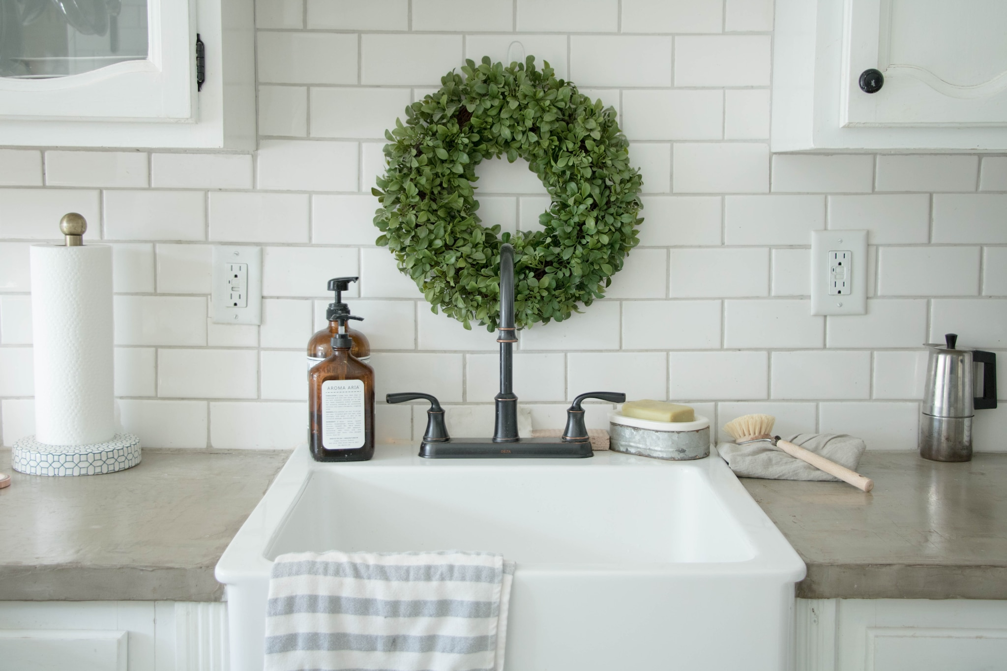 concrete countertop surrounding white sink