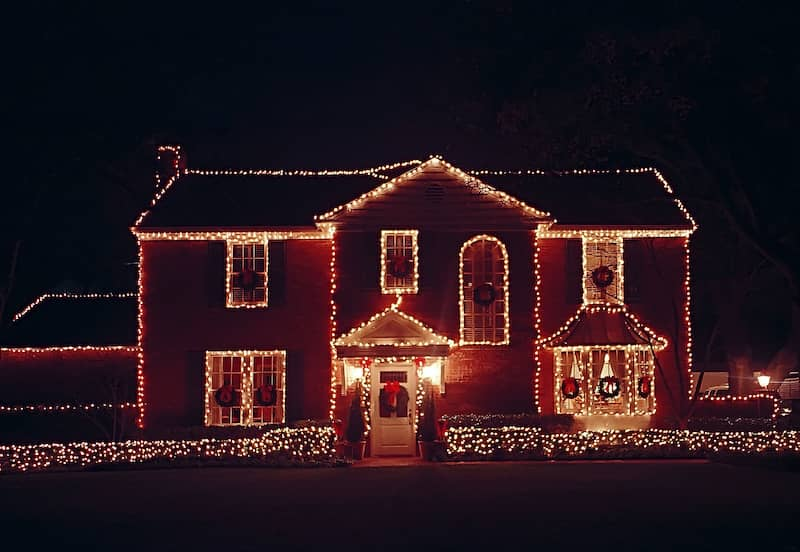 House lined with colorful outdoor lights
