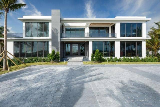 large contemporary home with floor to ceiling windows