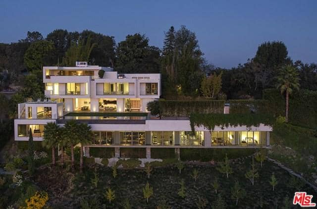 4 story home surrounded by greenery