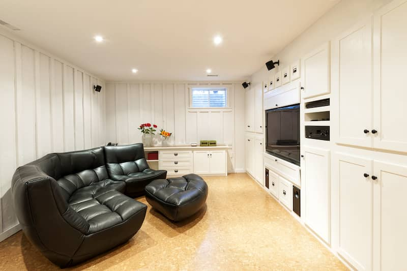 basement with cozy couch and tv