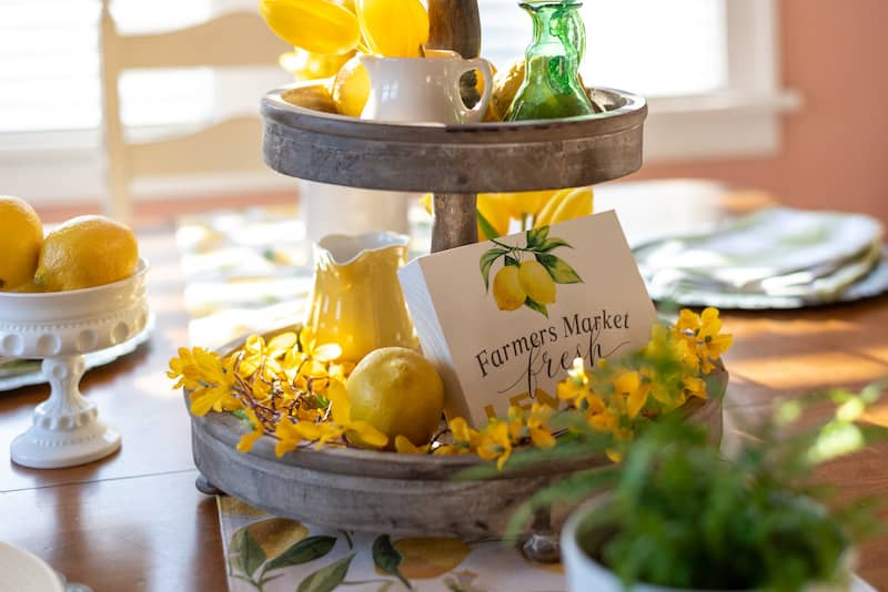Dining table with spring decor on a tiered treat stand.