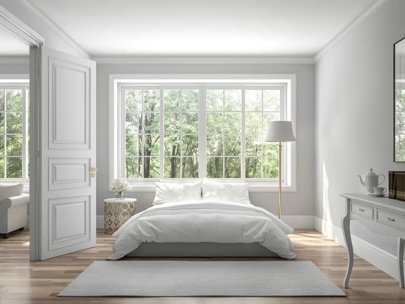 bright white bedroom with lighting around the window