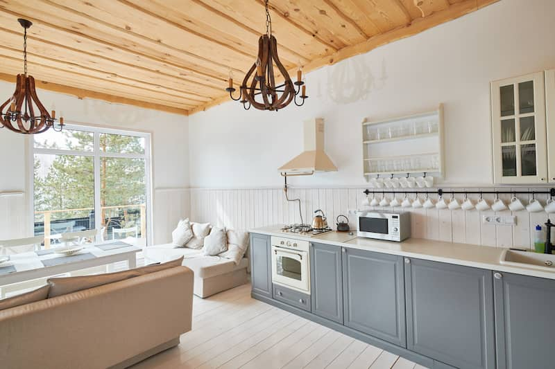 kitchen with pine ceiling, white walls, and grey cupboards