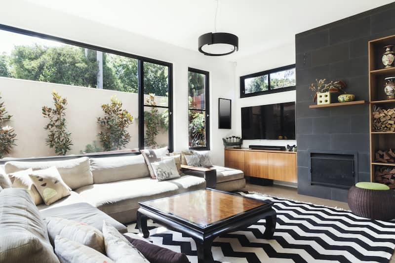 living room with zig-zagged black and white tile floor