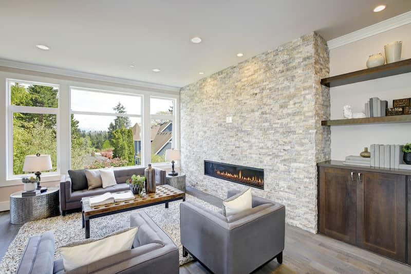 natural stone wall in living room with fireplace