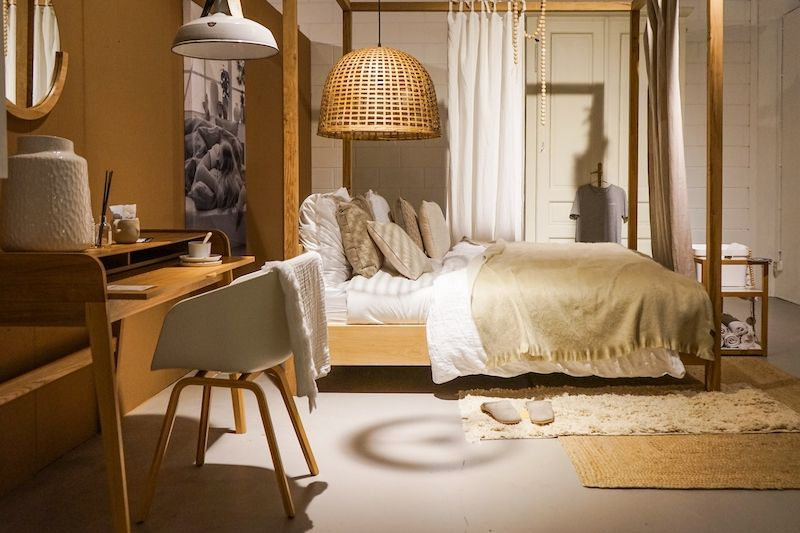 Boho bedroom with lots of texture and soft light.