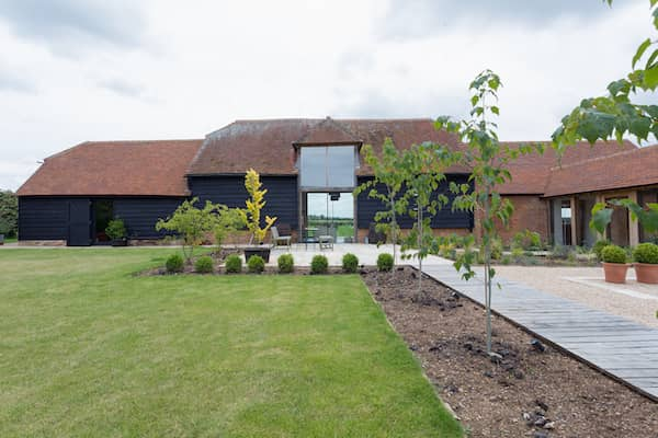 Large converted barn home with vast yard.