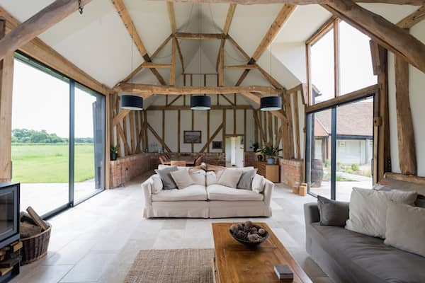 Open barn living room with large windows.