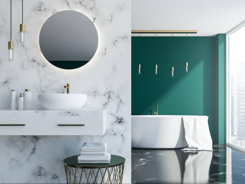 bathroom with green accent wall