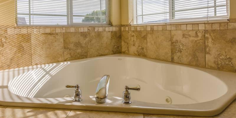 Corner tub in corner of bathroom