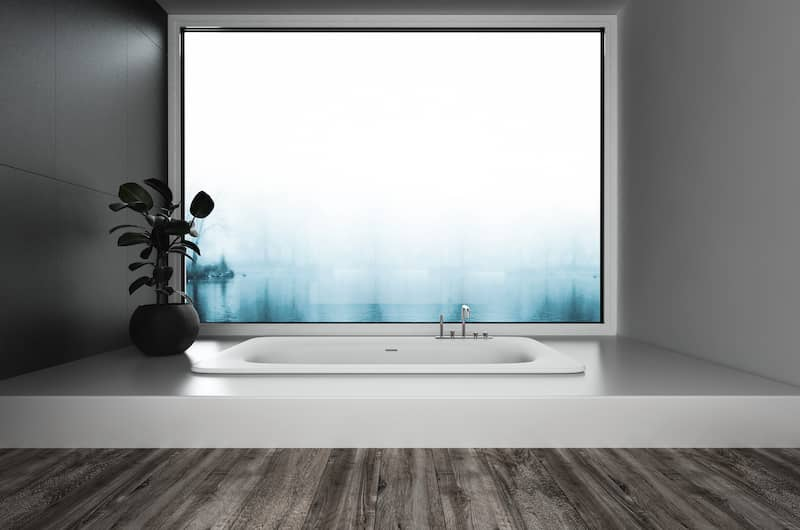 large drop in tub in large bathroom in front of wall length movie