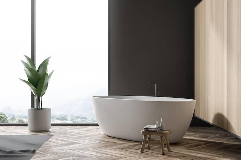 Free standing bathtub in modern, open bathroom.