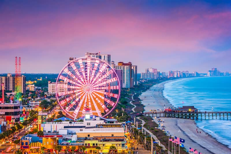 Myrtle Beach, South Carolina beach lined with ferris with carousel and beach condos