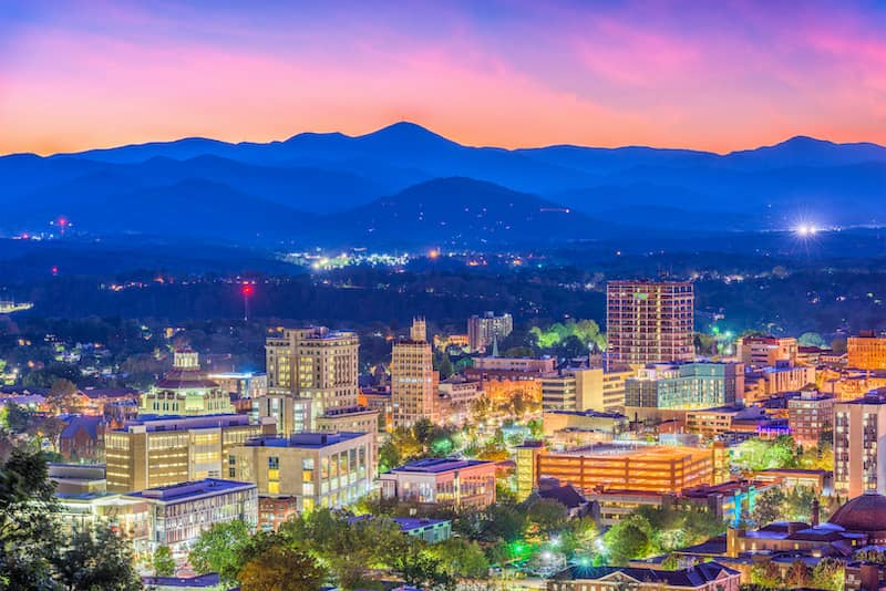 Asheville, North Carolina Skyline at dusk with mountains in back