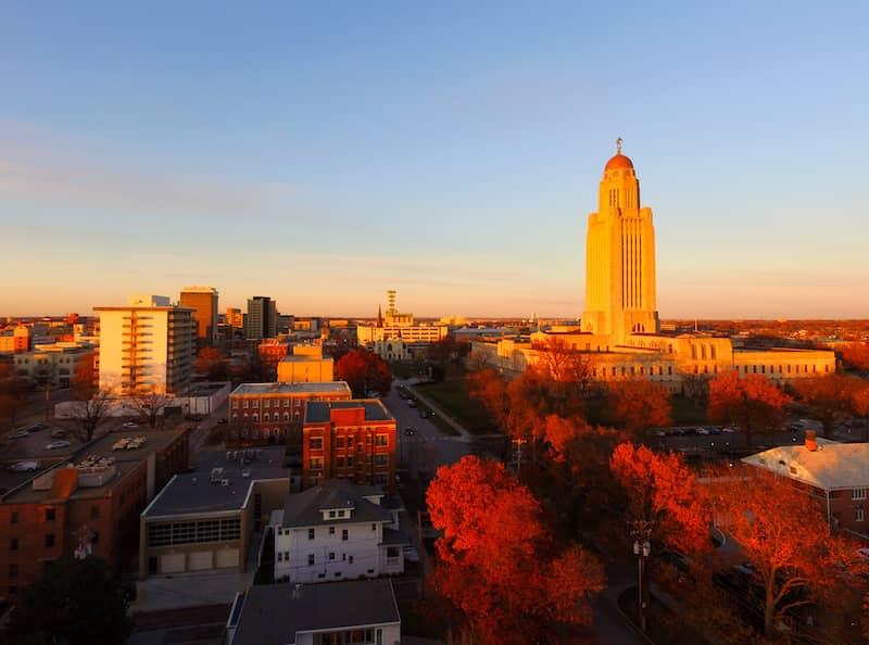 sun setting over Nebraska city