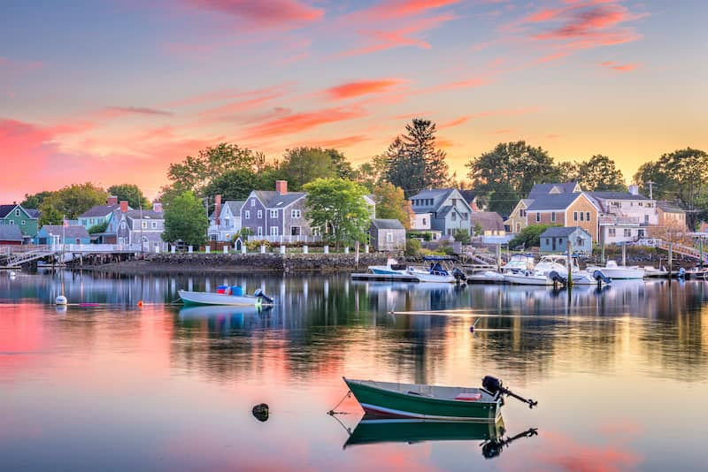 reflection of coastal town on calm water