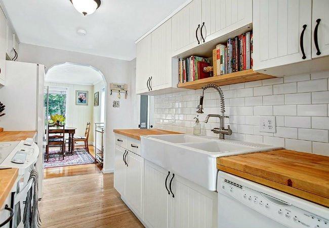 wood butcher block countertops in white kitchen