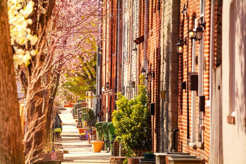 Baltimore Streets With Brick Houses And Cherry Blossoms