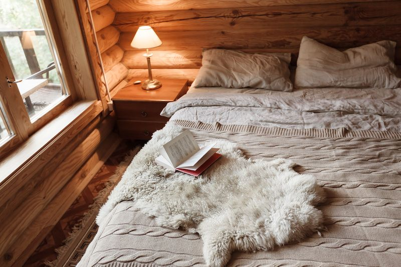 Cozy cabin bedroom with furs.
