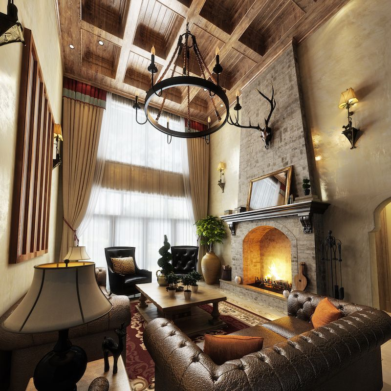 Cabin room with high ceilings, leather furniture and a fireplace.