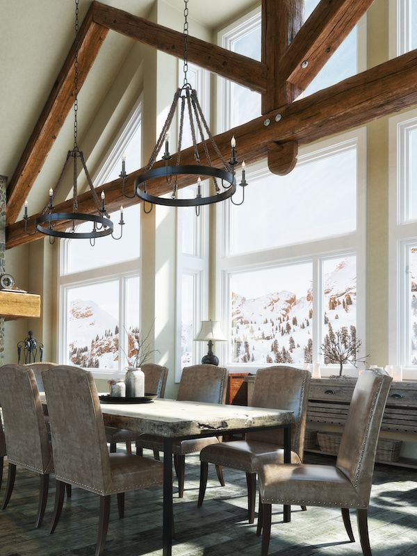 Rustic cabin dining room with high ceilings.