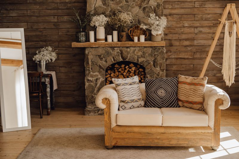 Rustic cabin couch and fireplace.