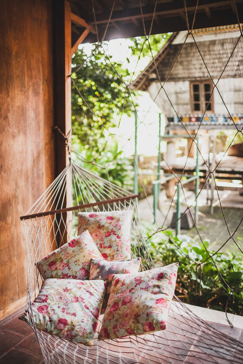 Hammock with pillows outside.