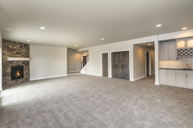 Carpeted living room with fireplace.