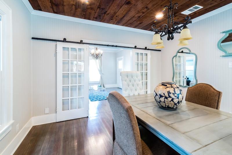 Dining room with sliding barn doors.