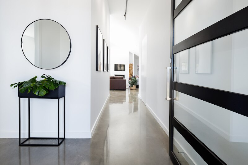 Modern entryway with concrete floors.