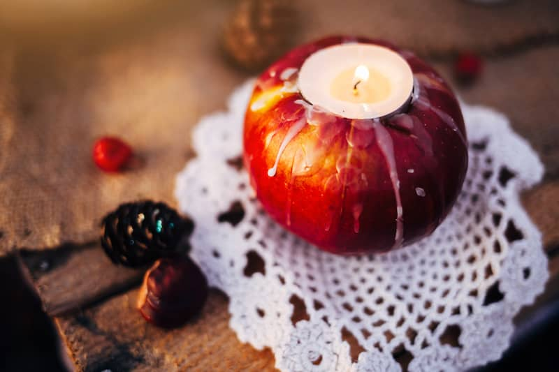 Candle burning in an apple.