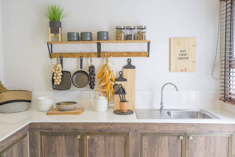 Rustic kitchen mixing metal and wood textures.