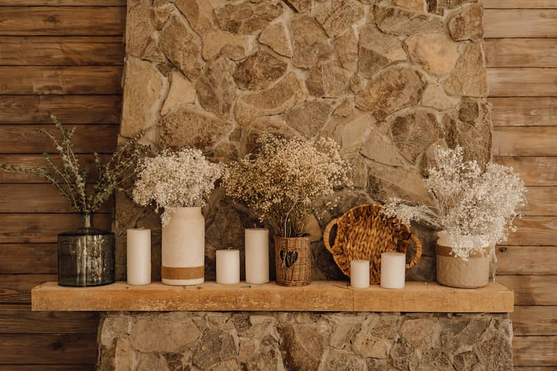 Wooden mantel with fall decor.