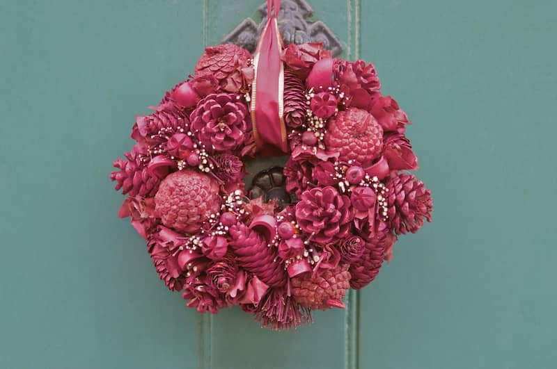 Bright pink pinecone wreath.
