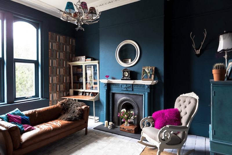 Jewel-toned room with unique, eclectic furniture.