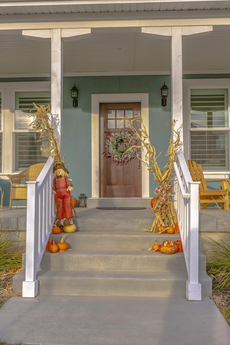 Corn stalks lining a porch.