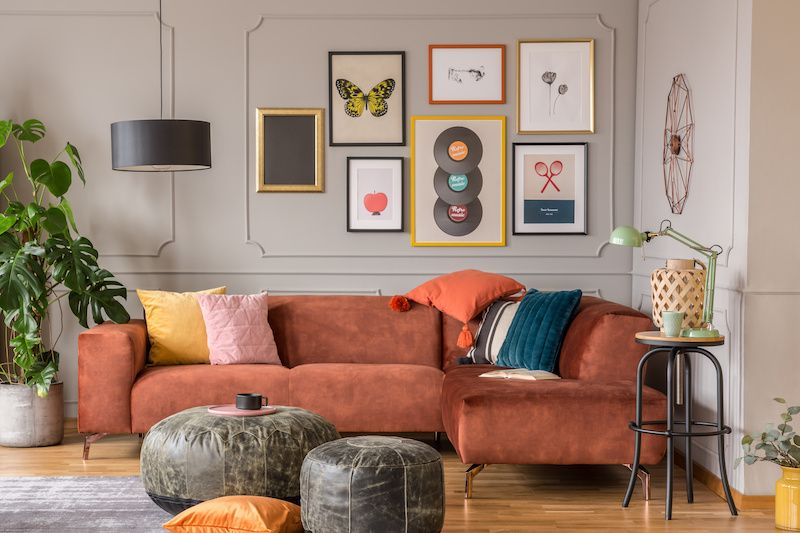 bohemian style family room with burnt sienna couch