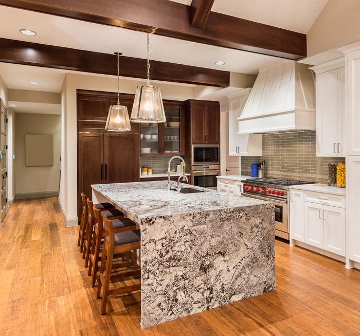 granite floating countertop in a kitchen with a hardwood floor